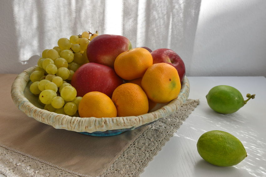 Apple - Fruit Bowl Choice Citrus Fruit Close-up Food Food And Drink Freshness Fruit Grapes Healthy Eating Indoors  Lime Multi Colored No People Orange Orange Color Still Life Table Tangerine Variation Wellbeing