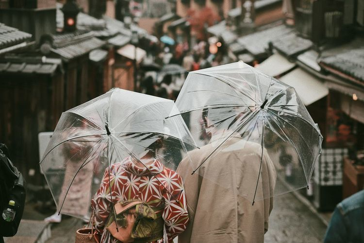 Couple Japanese Culture Rainy Days Relationship Adult Architecture Built Structure City Focus On Foreground Incidental People Kyoto Lifestyles Moody Outdoors People Protection Rain Rainy Season Real People Rear View Street Streetphotography Transparent Umbrella Wet The Traveler - 2018 EyeEm Awards The Street Photographer - 2018 EyeEm Awards