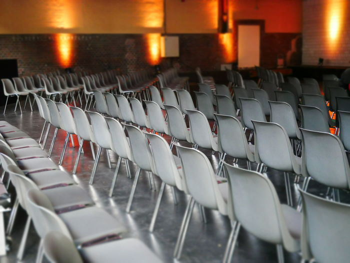 Empty Places Event Waiting Arrangement Auditorium Chair Empty Folding Chair Geometry In A Row Indoors  Large Group Of Objects Meeting Room No People Perfect Seat Modern Workplace Culture