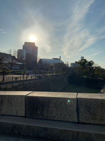 Buildings against sky on sunny day