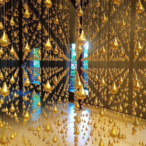 Beautifully Organized Indoors  Gold Colored Hanging Large Group Of Objects No People Artinstallation Light And Reflection. Tranquility Geometric Shapes