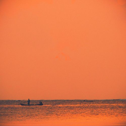 EyeEmNewHere Sunset Sea Copy Space Water Scenics Nature Silhouette Beauty In Nature Real People Tranquil Scene Tranquility Outdoors Waterfront Men Two People Horizon Over Water Lifestyles Clear Sky Sky Day sunrise EyeEmNewHere