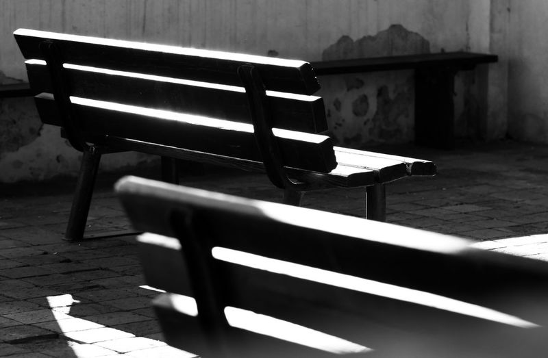 Empty bench on table in park