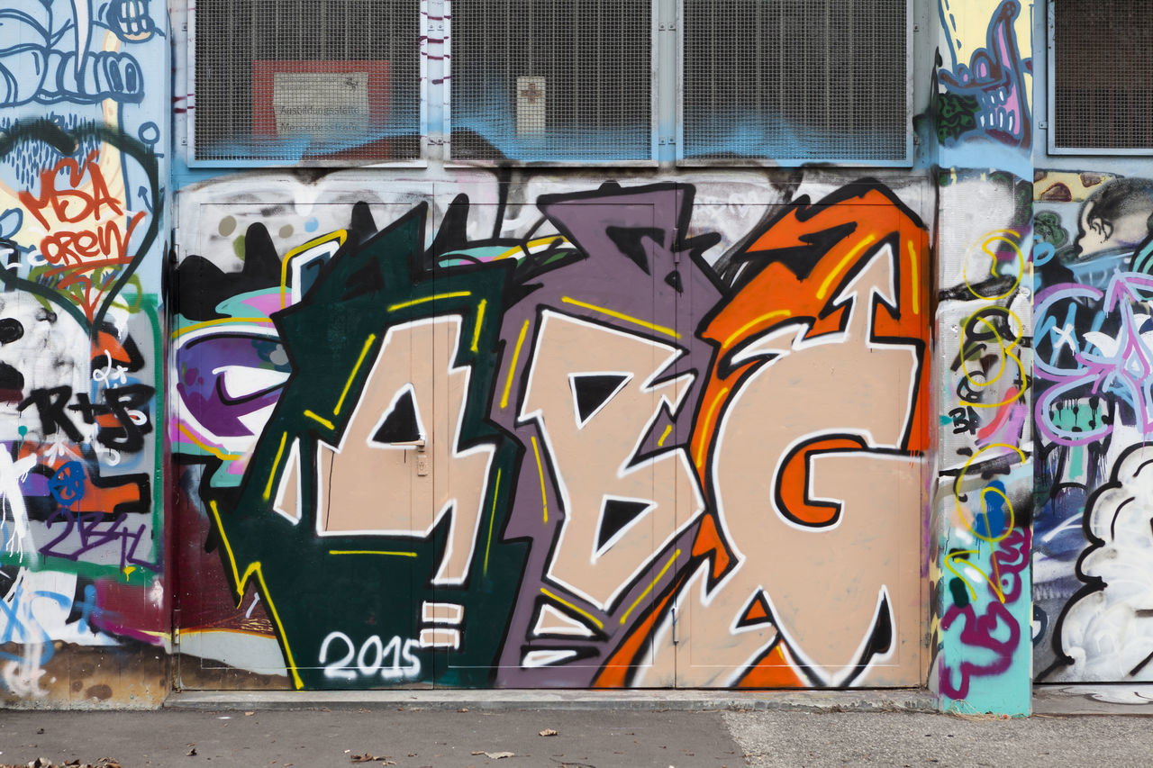 graffiti, multi colored, street art, text, built structure, art and craft, architecture, outdoors, building exterior, day, no people, city, close-up