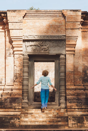 Rear View Of Mid Adult Woman Standing At Angkor Wat Entrance