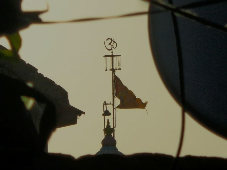Shadow Communication Silhouette Close-up Outdoors Day Built Structure Building Exterior No People Flag Temple Top Of Temple First Eyeem Photo Motion Sunset Gujarat India God Omkar Weather Vane Architecture ૐ
