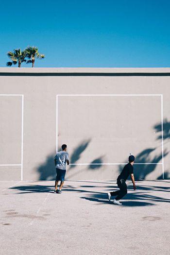 Boys playing wallball