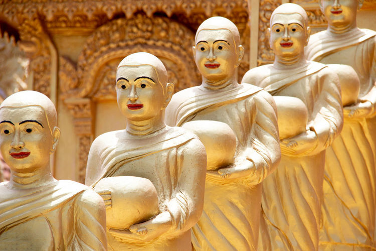 Buddha statues in row