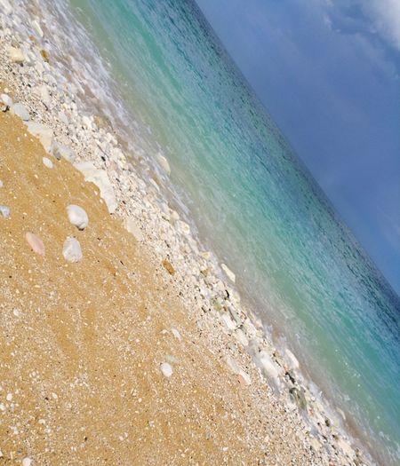 colori Blue Sky Sand Beauty In Nature My Point Of View Nature EyeEm Nature Colorized Contemplazione Fusione Acquarello Elementi Naturali Luce Sospesa, Tra Cielo E Terra Point Of View Cielo Drammatico Decadenza Colorata Water Sea Wave Beach Sky Horizon Over Water Turquoise Seascape Sandy Beach Rocky Coastline
