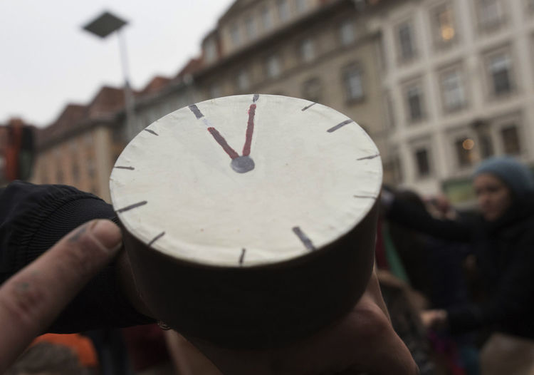 Close-up of person hand holding clock
