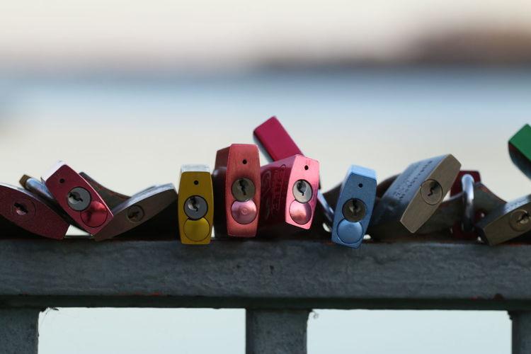 Colorful padlocks on railing