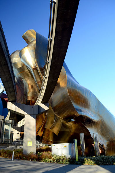Detail of the EMP museum structure in Seattle, where the monorail way enter the building Architecture Entrance EyeEmNewHere Frank Gehry Modern Perspective Reflection Seattle Space Needle Transportation Architecture Contemporary Details Emp Futuristic Architecture Metal Organic Shapes Outdoors Rail Way Shapes And Forms Steel Structure Texture Train