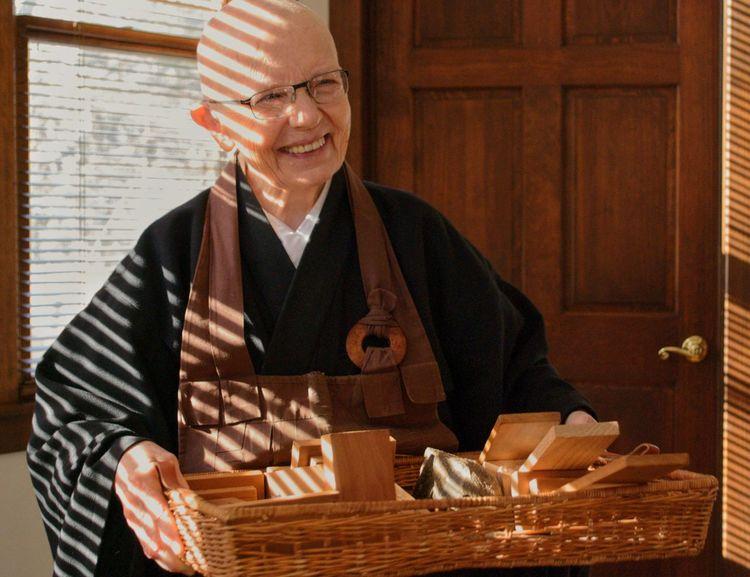 Senior Adult Eyeglasses  Adult One Person Buddhism Zen Smiling Darma Indoors  Working Working Seniors Day Spirituality Syracuse Ny Woman Happy
