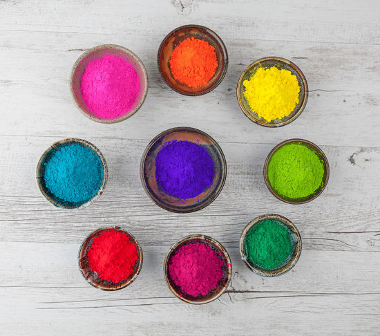Vibrant colorful Holi powder in cups arranged in circle. Top view. Holi Festival Choice Close-up Colorful Day Face Powder Green Color Holi Holi Powder Indoors  Multi Colored No People Powder Paint Red Talcum Powder Variation