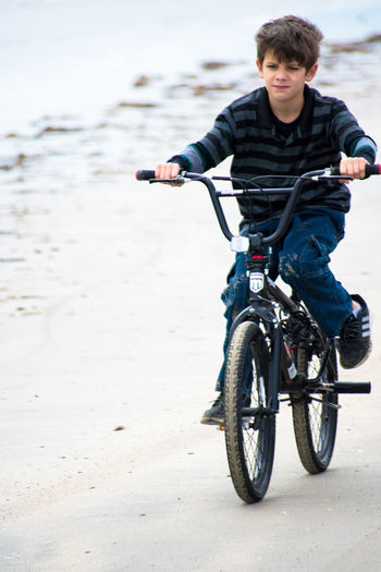 Man with bicycle on beach