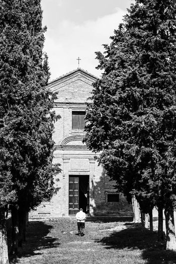 Alone Architecture Building Exterior Built Structure Church Day Full Length Growth Lifestyles Men Nature One Person Outdoors People Pienza Italy Place Of Worship Real People Rear View Sky Standing Tree Walking Women