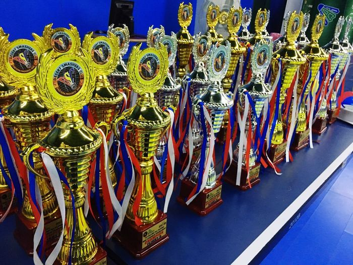 Silver and Gold Large Group Of Objects No People Multi Colored Hanging Variation Day Outdoors Blue Close-up Trophies🏆 AWARD Badminton Badminton Court Badminton Lover