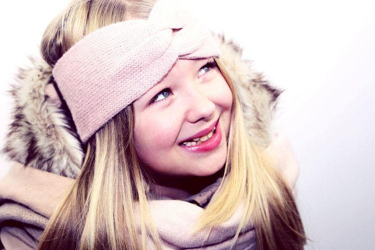 EyeEm Selects Warm Clothing Winter Cold Temperature Blond Hair Headshot One Person Portrait Long Hair Child Human Face Scarf Beautiful People Little Girl One Girl Only Smile Girl Smiling Wintertime Snow Winter Warm Clothes Having Fun Studio Shot It's Cold Outside Soft Colors