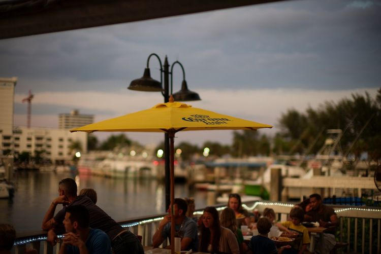 By the water Fort Lauderdale Beach A1A Las Olas Blvd #coconuts Leicacamera Noctilux LEICA M Streetphotography Group Of People Real People Crowd Men Architecture Large Group Of People Adult Lifestyles Water Cafe