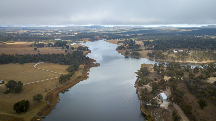 Aerial view of Storm King Dam under a blanket of fog on a winters morning in Stanthorpe, Queensland, Australia Beauty In Nature Cloud - Sky Day Environment High Angle View Land Landscape Nature No People Non-urban Scene Outdoors Plant River Scenics - Nature Sky Tranquil Scene Tranquility Tree Water