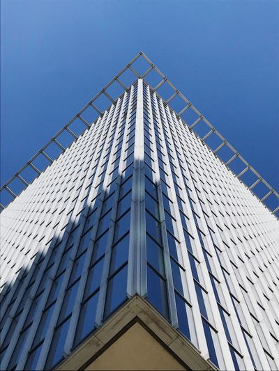 Geometric Architecture. Lines Triangle Triangle Shape Low Angle View Architecture Built Structure Building Exterior Building Sky Tall - High Office Modern City Office Building Exterior No People Day Clear Sky Tower Window Blue Skyscraper Pattern