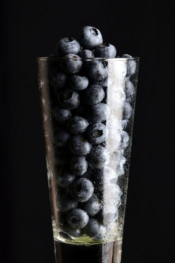 Close-up of frozen fruit against black background