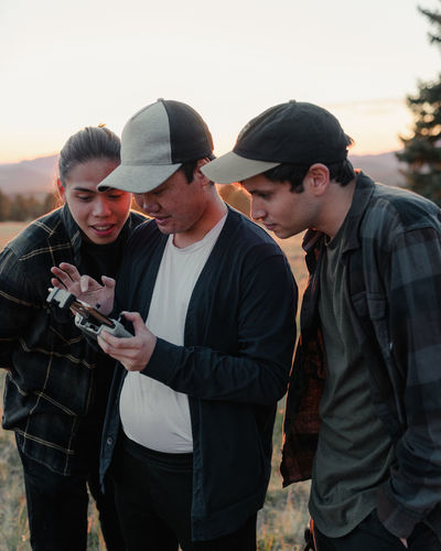 Group of friends reviewing drone footage