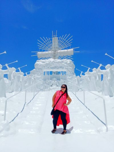 Woman Standing On Footpath At Garinfarm Pilgrimage Resort