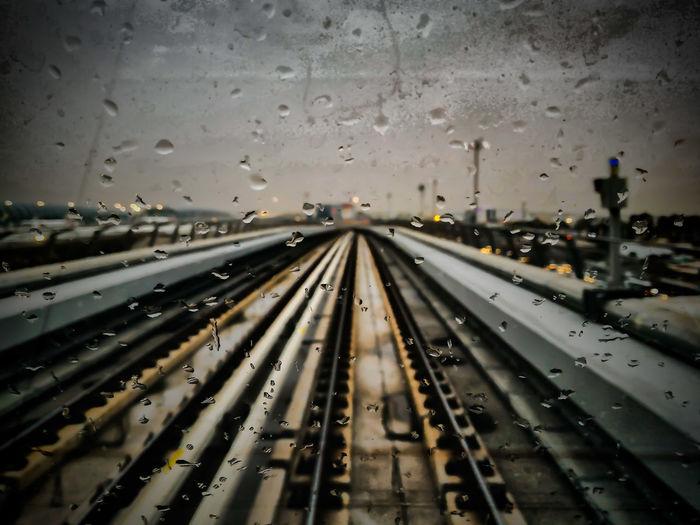 Railway bridge seen through wet window