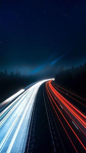 Light Trail Long Exposure Speed Motion Night Transportation Illuminated Road Blurred Motion High Street Traffic Sky Outdoors The Way Forward No People Blue