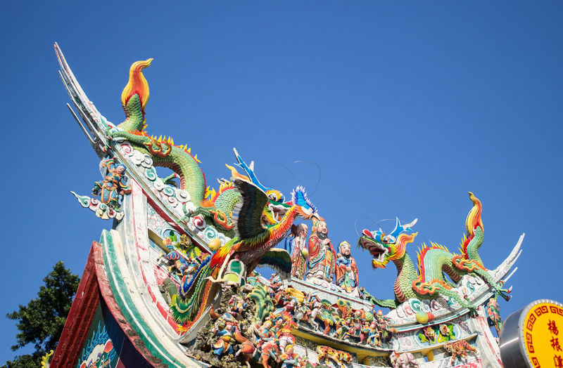 a traditional temple roof Blue Chinese Dragon Clear Sky Day Dragon Low Angle View Multi Colored No People Outdoors Sculpture Sky Statue Temple The Architect - 2017 EyeEm Awards Traditional