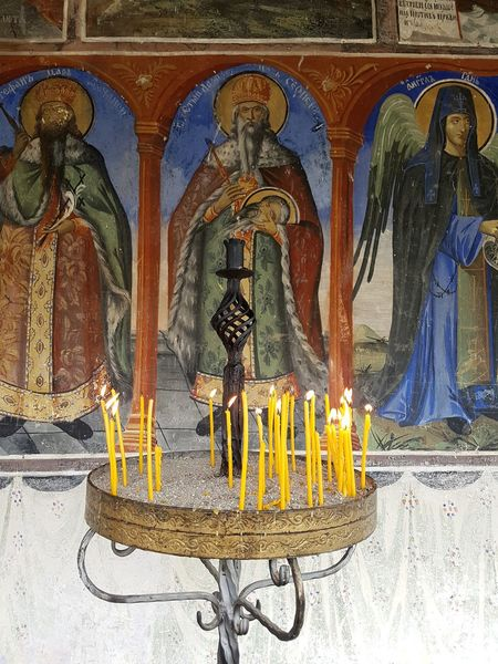 Monastery Jovan Bigorski Spirituality Religious Place Building Exterior Place Of Worship No People Religion Historical Monuments Historical Building Day Frescos Fresco Paintings Candles Candles Burning Candle Holder Rituals Art Paintings Culture Culture And Tradition Paint The Town Yellow