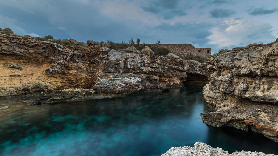 Comino Island Malta Malta Mediterranean Sea Nature Beauty In Nature Buildings Built Structure Cliff Comino Geology Island Landscape Long Exposure Nature No People Outdoors Reflections Rock - Object Rock Formation Rocks Scenics Sea Sky Tranquility Water