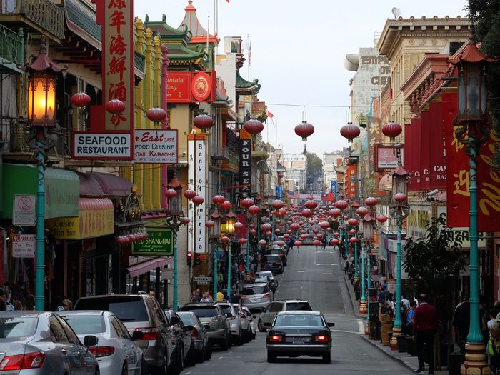 Cars Parked On Street Amidst Buildings At Chinatown
