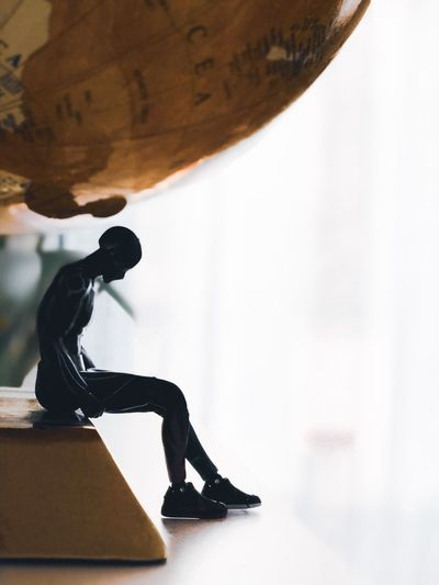 Low section of man statue on table