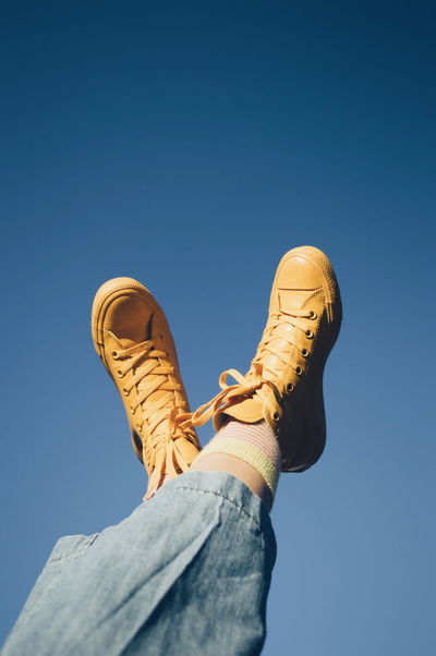 Paint The Town Yellow Blue Low Angle View Day Outdoors Fresh On Eyeem  Mom Jeans The Week On EyeEm All Stars Sky Up And Up Vscocam Shoes Fashion Crazy Socks  Yellow Fresh On Market 2017 Visual Creativity #FREIHEITBERLIN
