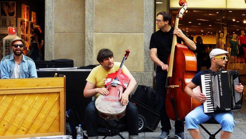 Summer In The City Adult Artist Arts Culture And Entertainment Casual Clothing Entertainment Occupation Group Of People Guitar Holding Leisure Activity Men Music Musical Equipment Musical Instrument Musician People Performance Playing Real People Sitting String Instrument Women