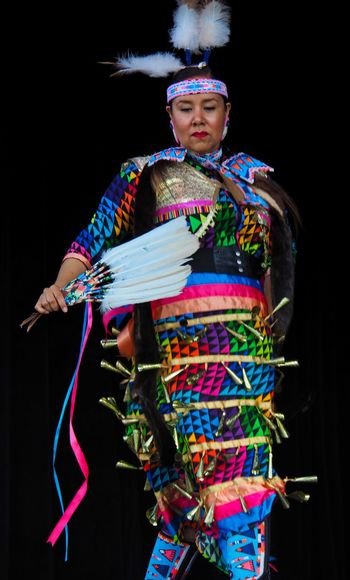 Jingle Dancer Dancing First Nations Adult Black Background Colourful Dress Cultural Dance Cultural Heritage Female Dancer Front View Headdress Headwear Indigenous Culture Indigenous Woman Multi Colored Native American One Person Performance Real People Regalia Symbolic  Traditional Clothing The Portraitist - 2018 EyeEm Awards