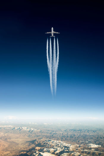 Aerial View Airliner Airplane Beauty In Nature Blue Day Flying Freedom Idyllic Jet Landscape Majestic Mid-air Motion Nature No People Outdoors Power In Nature Scenics Sky Smoke - Physical Structure Tourism Tranquil Scene Tranquility Travel Destinations