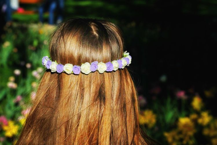 Rear View Of Woman Wearing Flower Headband