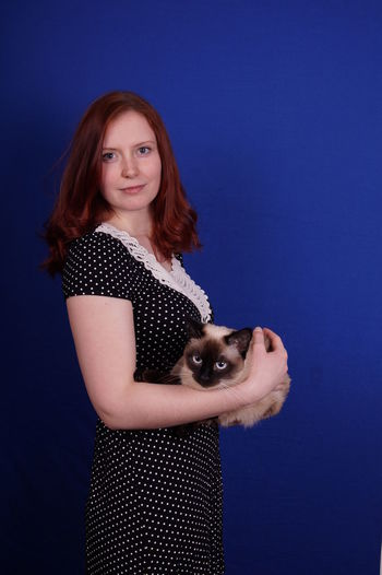 Portrait Of Young Woman Holding A Cat
