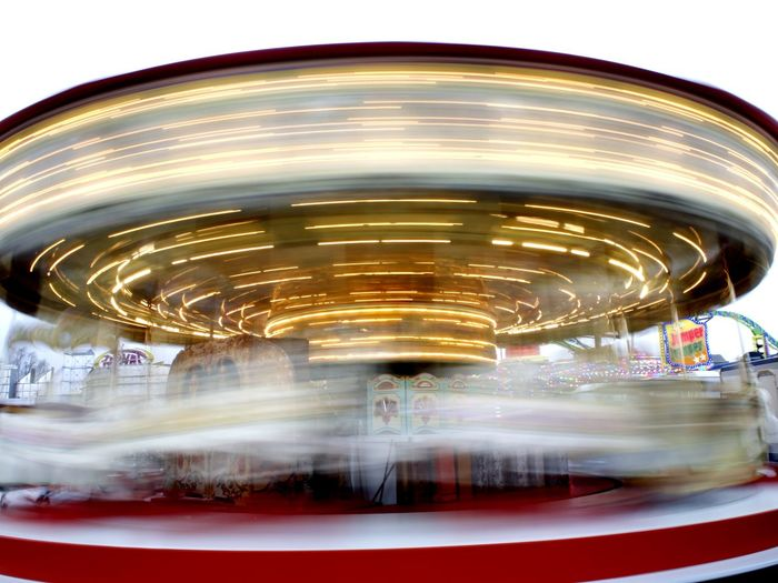 Amusement Park Amusement Park Ride Arts Culture And Entertainment Blurred Motion Carousel Check This Out Concentric Day Gold Colored Illuminated Long Exposure Motion No People Outdoors Sky Speed Spinning Taking Photos