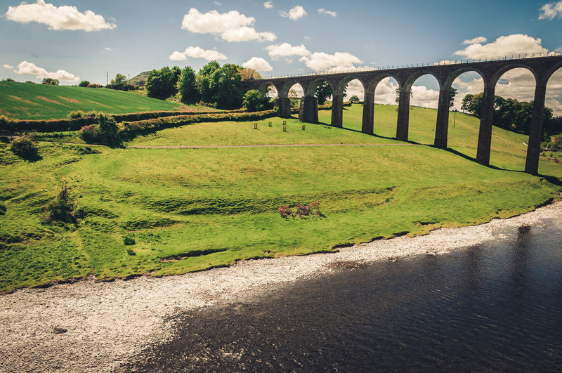 the grass is greener. Architecture Beauty In Nature Blue Sky White Clouds Bridge - Man Made Structure Built Structure Connection Day Great Britain Nature Nice Weather No People Outdoors Railway Bridge Scotland Sky Summertime Transportation Travel United Kingdom Water
