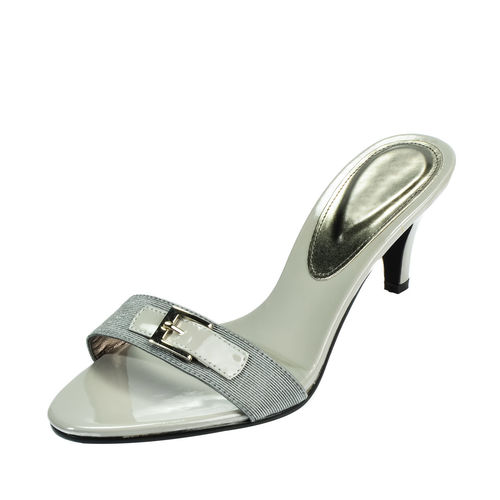 Close-up of high heel against white background
