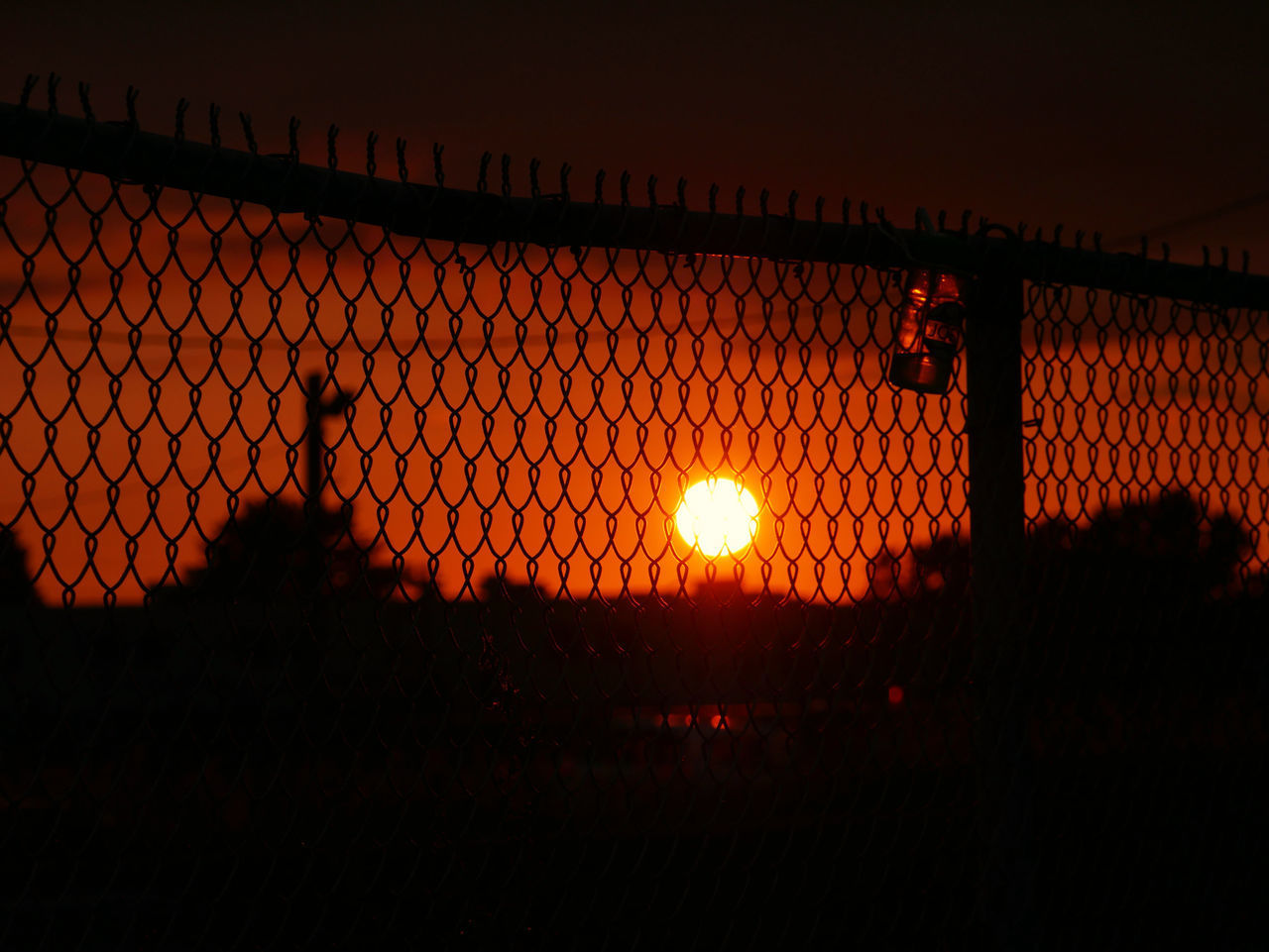 sunset, sky, fence, orange color, barrier, silhouette, nature, boundary, chainlink fence, beauty in nature, sun, glowing, outdoors, illuminated, no people, safety, security, protection, lens flare