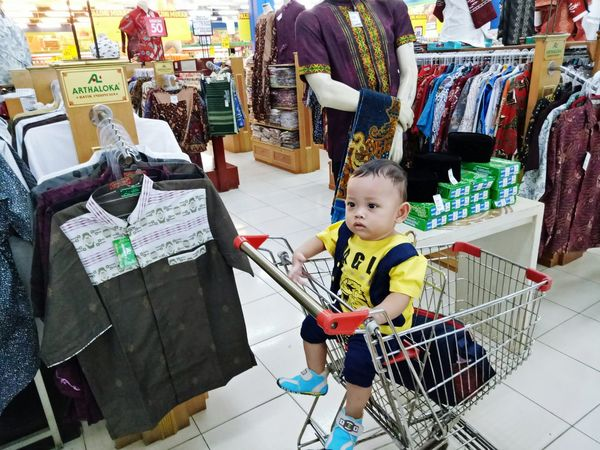My son shopping, wooowww😘 Baby Supermarket Babies Only Retail  Store Shopping Cart Consumerism Business Finance And Industry Market Buying Full Length Variation Indoors  One Person People Customer  Groceries Price Tag Business Childhood First Eyeem Photo