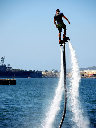 Fly Day Extreme Sports Extreme Water Park Extreme Water Sport Fly Board Fly On Water Flyboarding Leisure Activity Lifestyles Men Motion Motion On Water One Person Outdoors Real People Sea Stunt Sport Water Stunts
