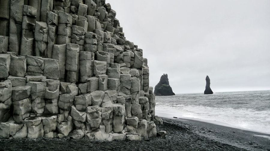 Natural basalt rock formation at black sand beach of reynisfjara