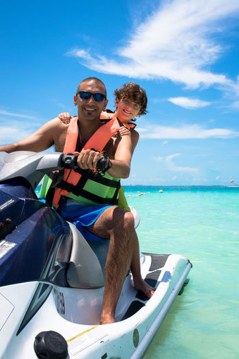 Jet-ski Fun Holidays Jet Ski Summertime Tropical Paradise Adventure Boys Childhood Family With One Child Father & Son Jetski Leisure Activity Lifestyles Ocean Outdoors Real People Riding Sea Smiling Son Togetherness Vacations Water Water Sports Wave Runner Summer Exploratorium