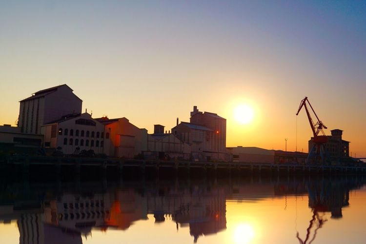 Miles Away Reflection Sunset Architecture Water Building Exterior Built Structure Waterfront Sky Outdoors Sun No People City Nature Beauty In Nature Travel Street City Reflection Water Sunset